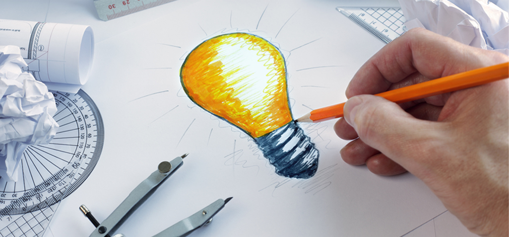 Hand holding a pencil drawing a lightbulb.  We have great ideas for your business